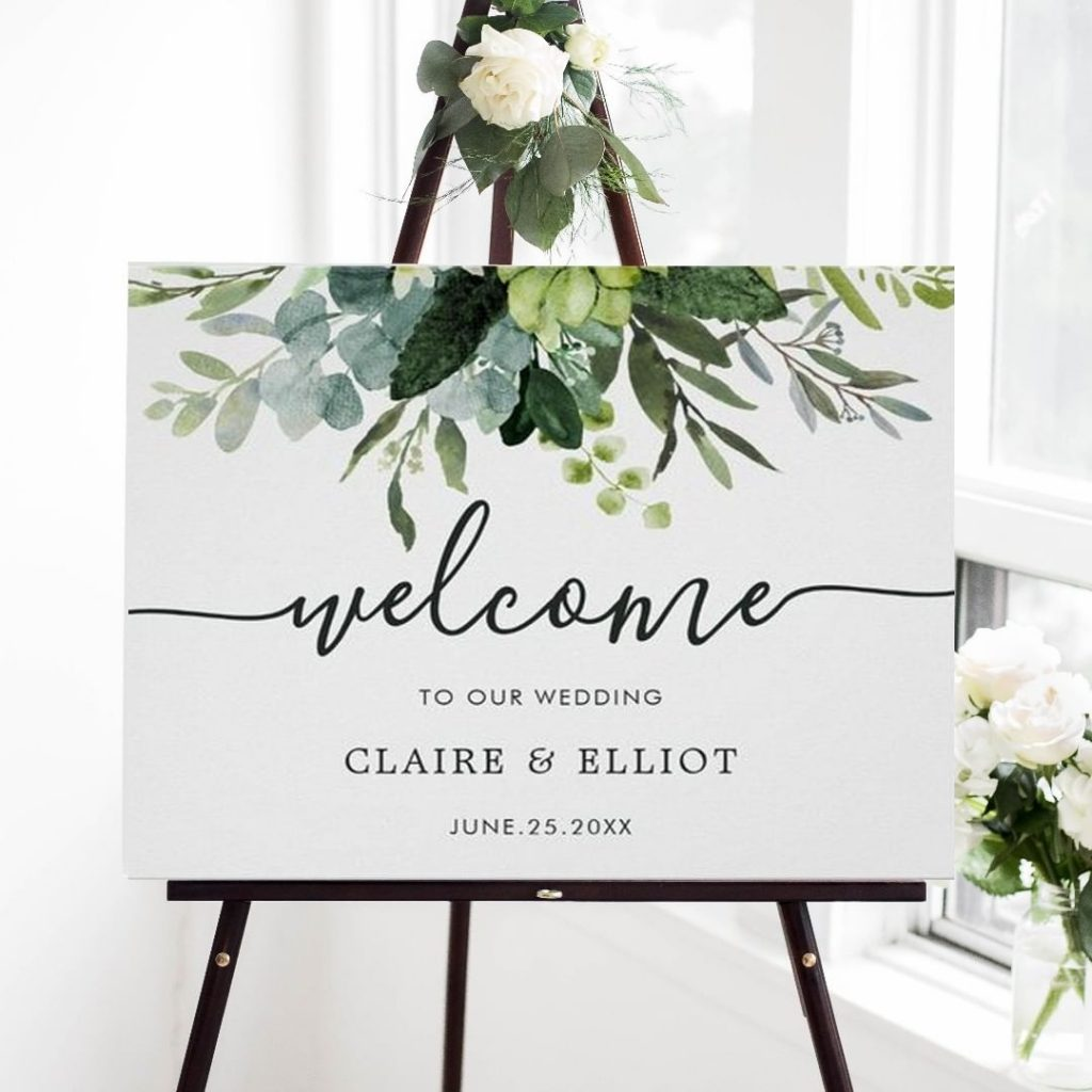 painted watercolor eucalyptus and green leaves wedding welcome sign