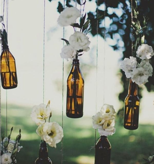 DIY Backyard Wedding Decorations On a Budget Beer bottles and white flowers