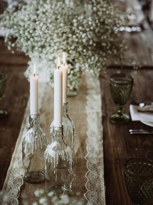 DIY Backyard Wedding Decorations On a Budget Candle Holders clear glass bottles and Taper  candles