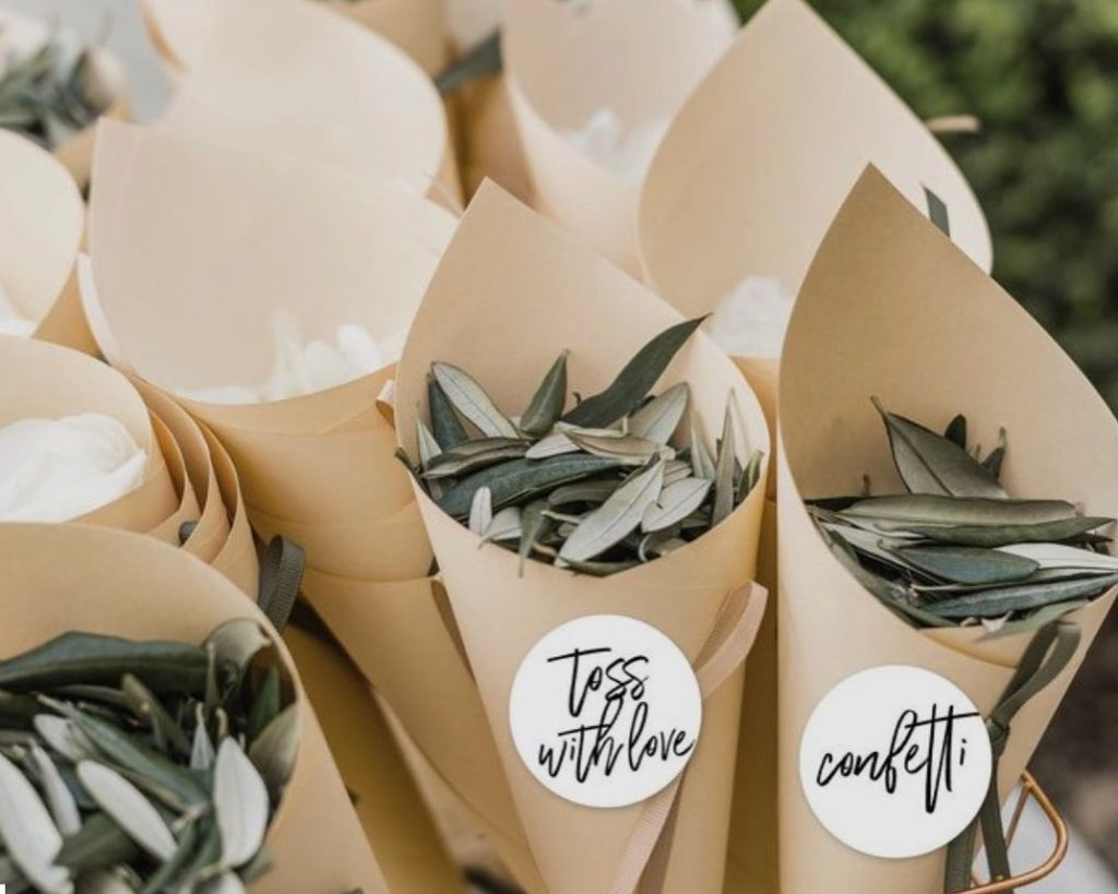 DIY Backyard Wedding Decorations On a Budget Kraft Paper a cones filled with Greenery Confetti